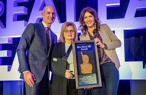 Photo of Jim Hagen, Teri Schmidt, and Governor Kristi Noem